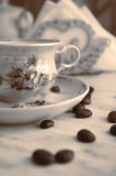 Vintage cup of coffee and coffee beans Stock Photo