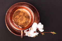Vintage cup of coffee with flower on black Stock Photography
