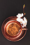 Vintage cup of coffee with flower on black Royalty Free Stock Photos