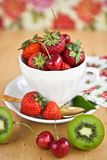 Vintage cup filled with fruit Royalty Free Stock Images