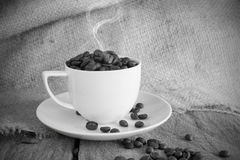 Vintage cup of roasted coffee beans in black and white tone Stock Photo