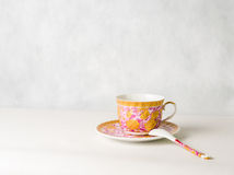 Vintage cup, saucer and spoon. On a white background Royalty Free Stock Photography