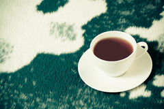 Vintage cup of tea on the blanket Stock Photography