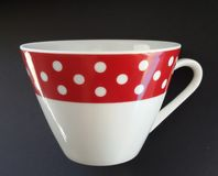 Vintage cup of tea. Cup of coffee. Beautiful retro design. Vintage design with polka dots. Cup of tea or coffee over black background royalty free stock photos