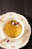 Vintage cup of tea with rosebuds, on black background Royalty Free Stock Photography