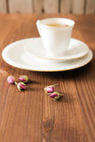 Vintage cup of tea with rosebuds,on brown background Royalty Free Stock Photo
