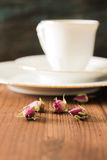 Vintage cup of tea with rosebuds,on brown background Royalty Free Stock Image