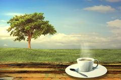 Vintage cup on wooden table Stock Photo
