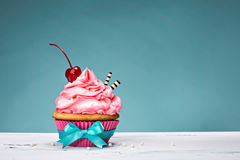 Vintage Cupcake with Cherry on Top Royalty Free Stock Images