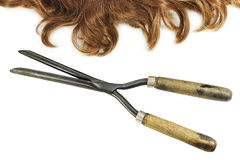 Vintage curling tongs and waved hair Royalty Free Stock Photos