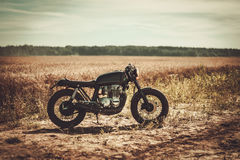 The vintage custom cafe racer in a field Stock Photos