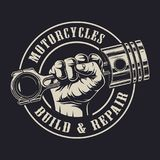 Vintage custom motorcycle logotype concept. With hand holding engine piston in circle on dark background isolated vector illustration stock illustration