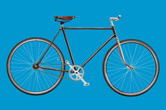 Vintage custom singlespeed bicycle isolated on blue background stock photo