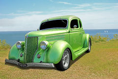 Vintage customised car. Photo of a metallic green vintage customised ford car on display at whitstable coast during 2016 Stock Photos