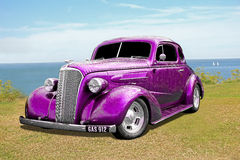 Vintage customised car. Photo of a metallic purple vintage customised ford car on display at whitstable coast during 2016 Stock Images