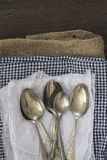 Vintage cutlery on cloths on rustic wooden background Royalty Free Stock Photography