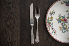 Vintage cutlery and crockery on wooden table Royalty Free Stock Photos