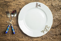 Vintage cutlery and dish old background Stock Photo