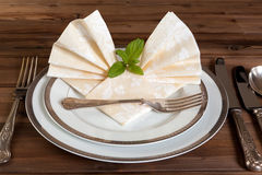 Vintage cutlery and fancy napkins Royalty Free Stock Image