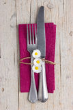 Vintage cutlery - fork and knife on purple napkin Stock Photography