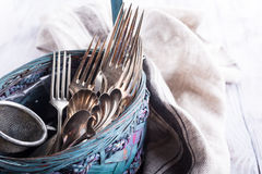 Vintage cutlery in old blue wicker basket Stock Photography