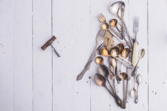 Vintage cutlery and old corkscrew. Stock Photos