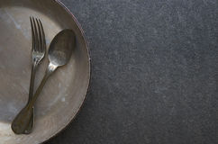 Vintage cutlery in old pan Stock Photo