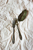 Vintage cutlery on a paper background Royalty Free Stock Photos
