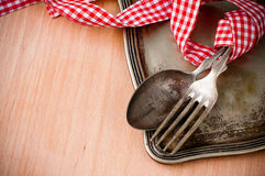 Vintage cutlery with red and white ribbon Stock Photo