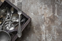 Vintage cutlery in retro suitcase Royalty Free Stock Photography