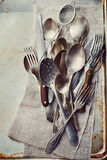 Vintage cutlery on rustic background, old kitchen tools from above Royalty Free Stock Photos
