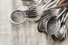 Vintage cutlery on rustic background, old kitchen tools Stock Photos