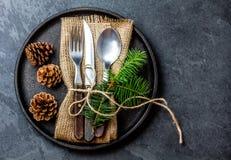 Vintage cutlery set, Christmas decoration on iron plate, slate background Stock Images