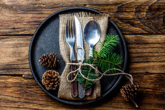 Vintage cutlery set, Christmas decoration on iron plate, wooden background Stock Image