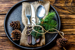 Vintage cutlery set, Christmas decoration on iron plate, wooden background Royalty Free Stock Image