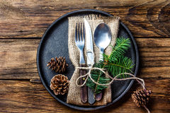 Vintage cutlery set, Christmas decoration on iron plate, wooden background Royalty Free Stock Photo