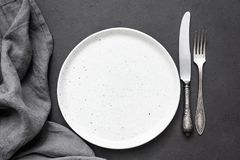 Vintage cutlery or silverware, empty plate and kitchen textile napkin. Top view, copy space for text Stock Photography