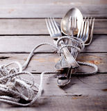 Vintage cutlery, spoon and forks roped Stock Photo