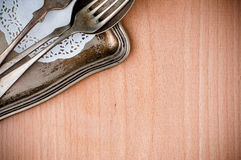 Vintage cutlery tray and old wooden board Royalty Free Stock Image