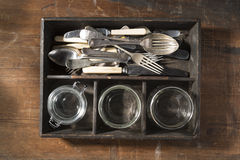 Vintage cutlery tray on wooden background stock images