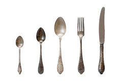 Vintage cutlery on the white background. Vintage silver cutlery on the white background Royalty Free Stock Images