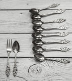 Vintage Cutlery on white wooden background Stock Images