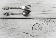 Vintage Cutlery on white wooden background Stock Image
