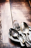 Vintage cutlery on wooden table Royalty Free Stock Photo