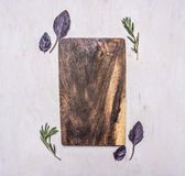 Vintage cutting board with herbs, rosemary  with text area wooden rustic background top view close up Stock Photography