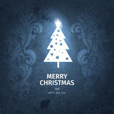 Vintage dark blue trendy Merry Christmas card and New Year wish greeting. Vector illustration with white christmas tree with shiny star on top, swirls for Stock Photography