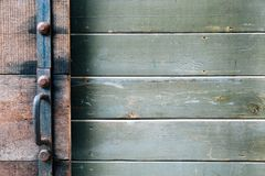 Vintage dark green and brown old wooden door wall