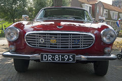 Vintage Dark red Volvo P 1800. MEDEMBLIK, THE NETHERLANDS - JULY 27,2014: Front view of a Volco P 1800 1964 on a oldtimer show on july 27,2014 in Medemblik Royalty Free Stock Photography