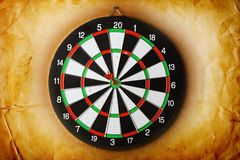 Vintage dart board on dark wall Stock Image