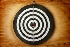 Vintage dart board on  dark wall Royalty Free Stock Photos